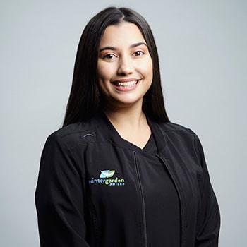 Claridad smiling in her uniform