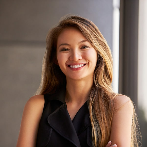 A young long haired woman smiling